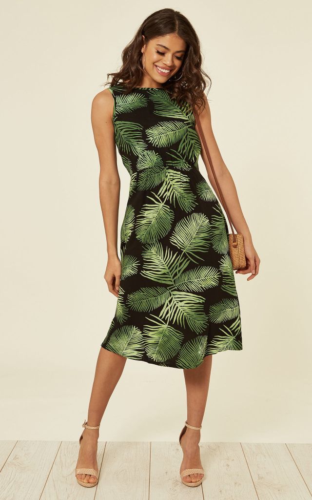 Sleeveless midi dress in green tropical print