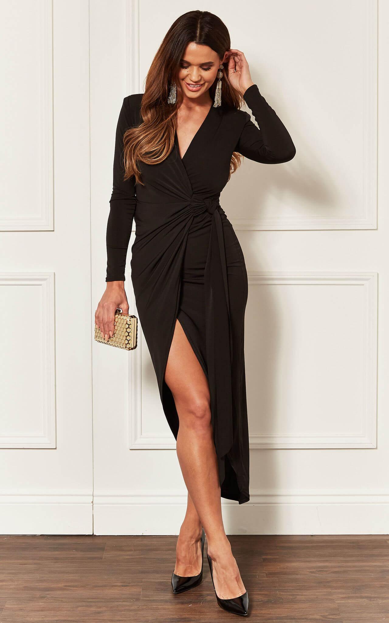 Model wears a black wrap midi dress with long sleeves