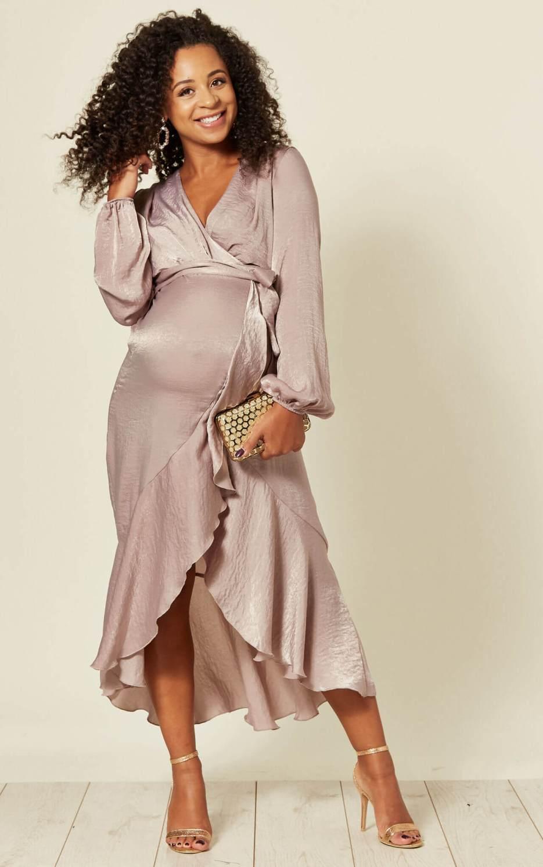 Pregnant model wears a wrap dress with frill hem