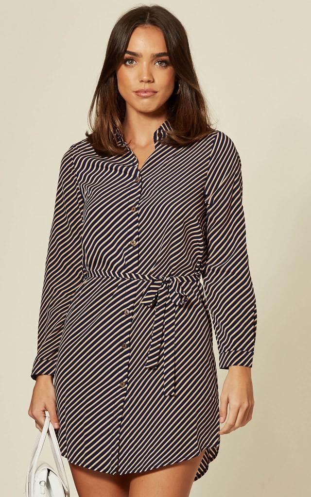 Model wears striped shirt dress in navy with belt