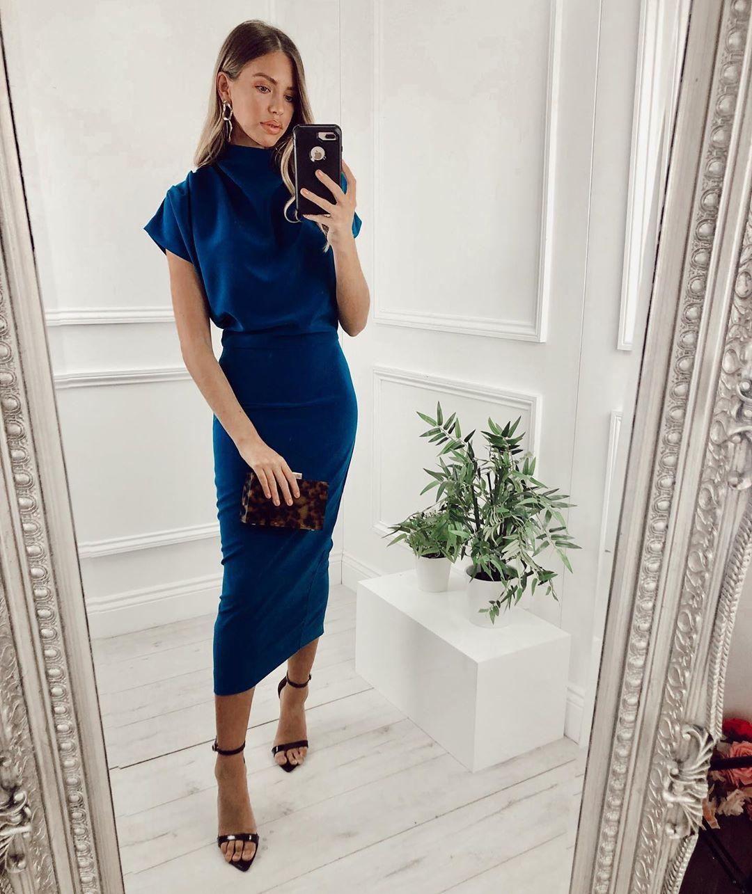 Model wears a high neck midi dress