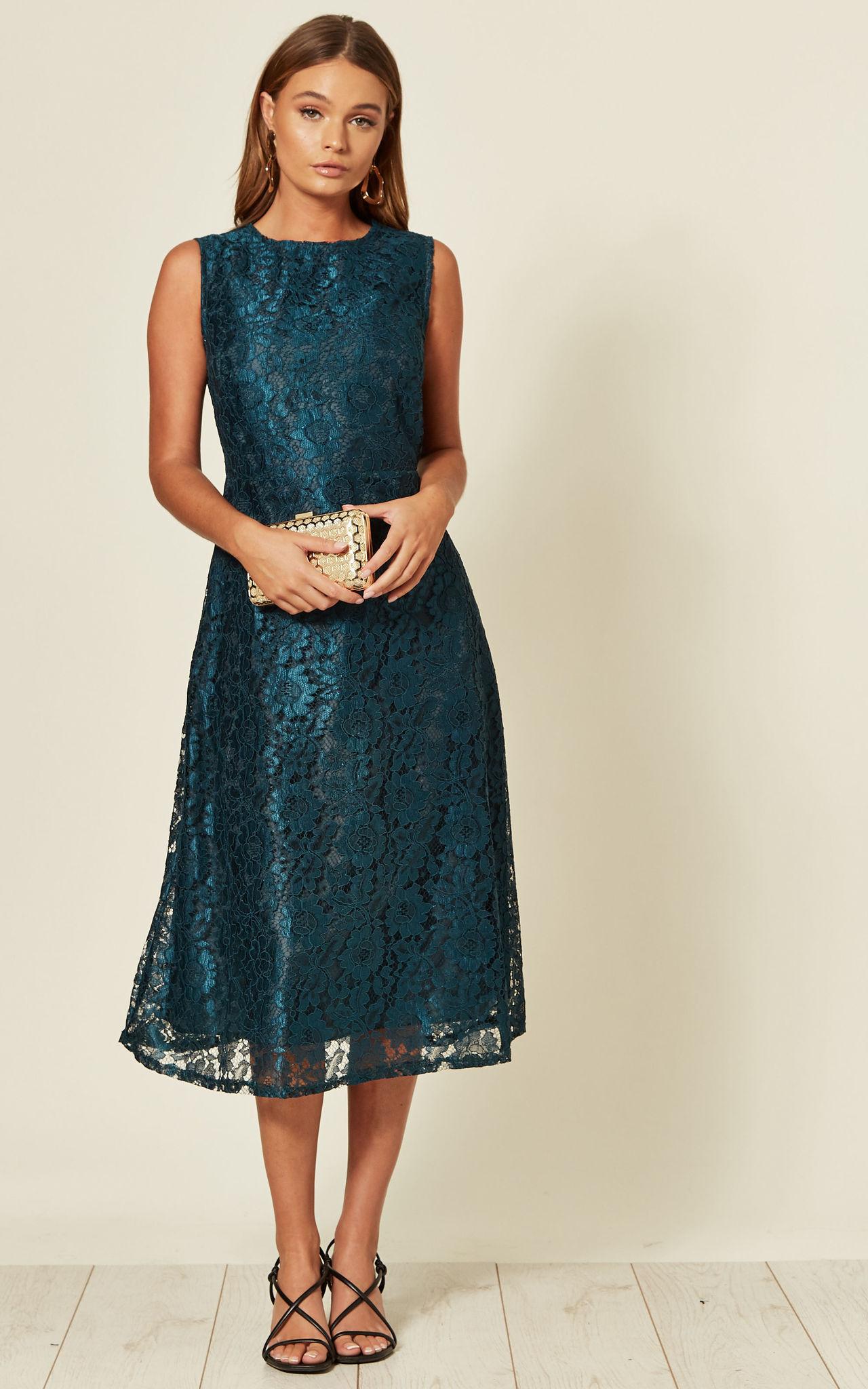 Model wearing a dark green lace dress