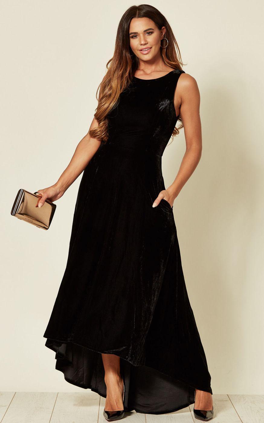 Model wears dipped hem velvet maxi dress