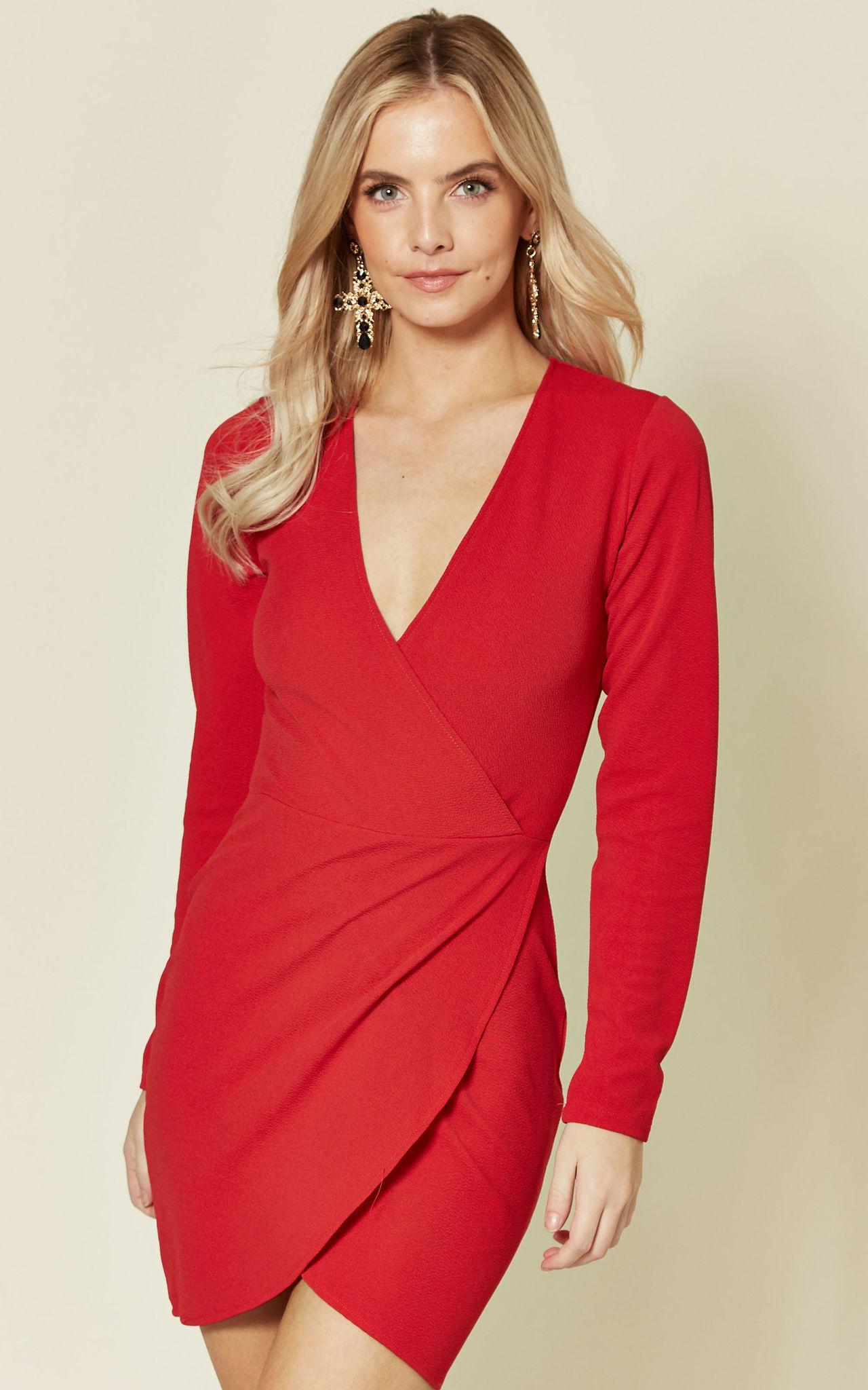 Model wearing red wrapover mini dress