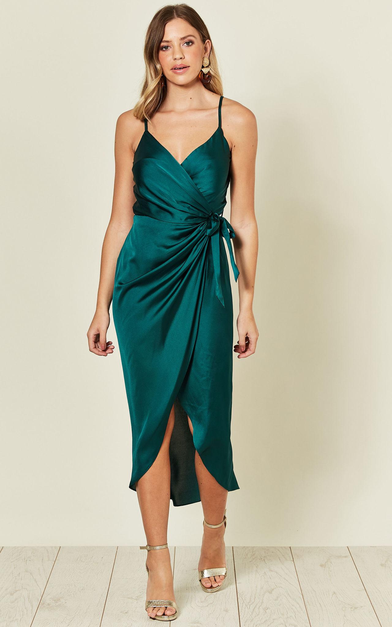 Model wears the tie side wrap cami dress in silky forest green