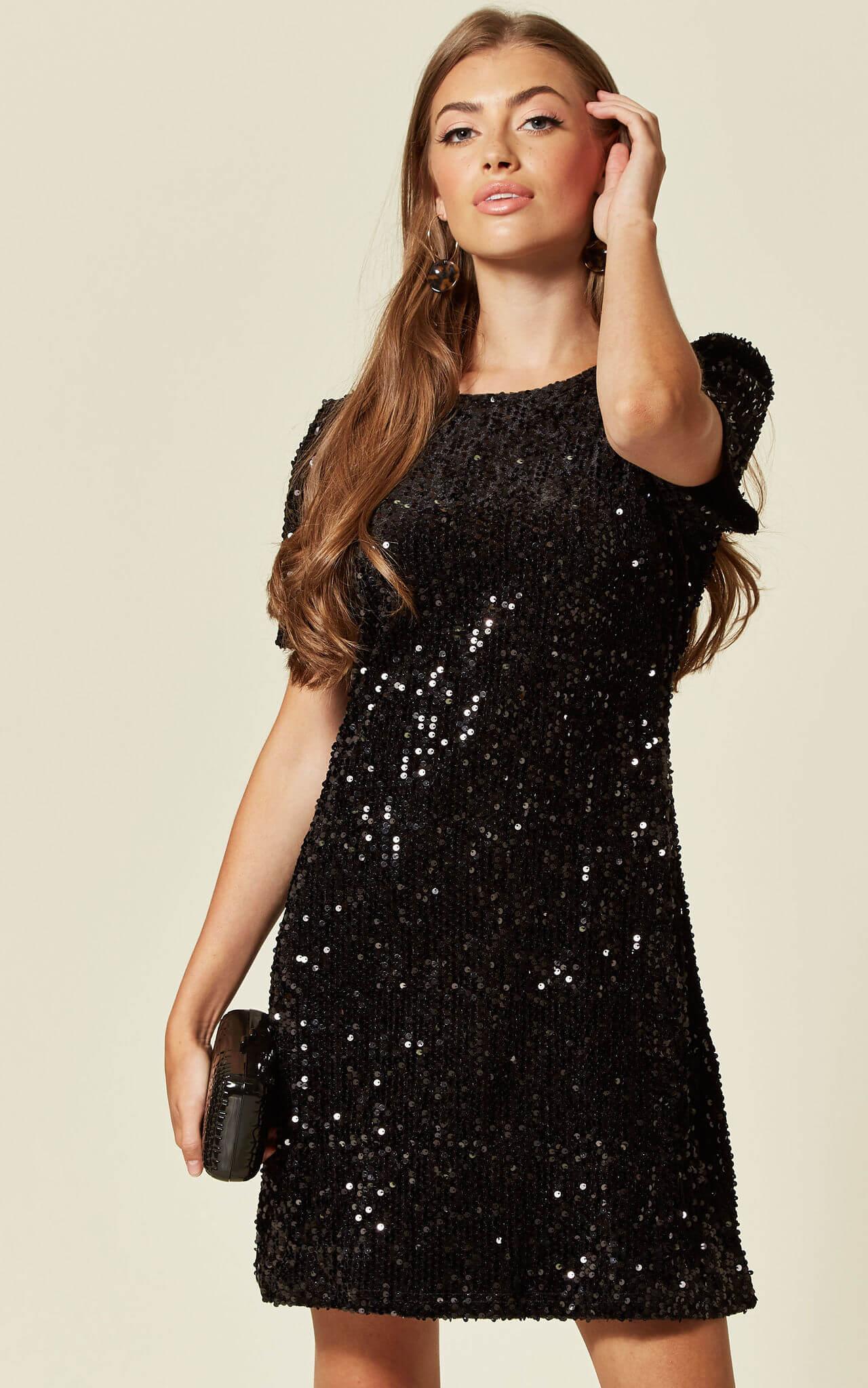 Model wears a sequin mini black dress