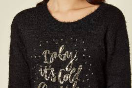 Model wears a grey Christmas jumper wiith sequin baby its cold outside slogan