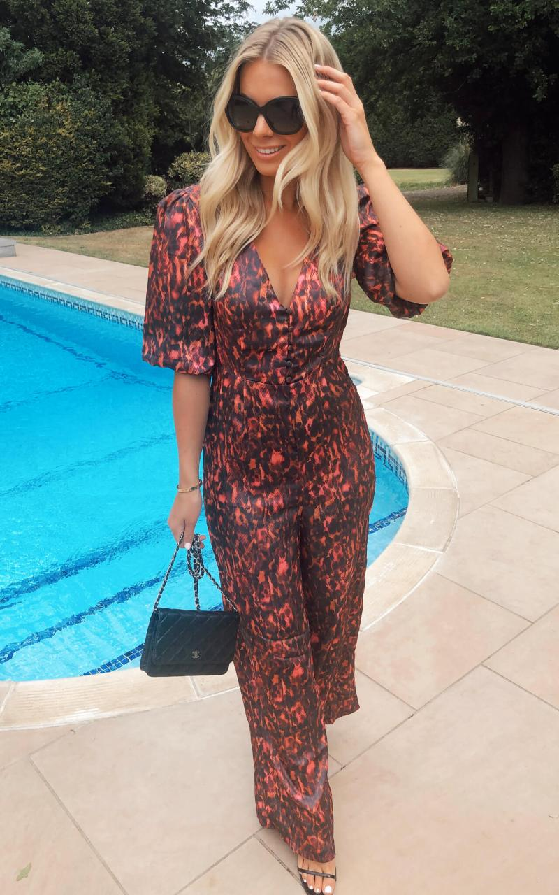 satin-jumpsuit-with-buttons-and-puff-sleeve-in-pink-animal-print_phoenix-and-feather