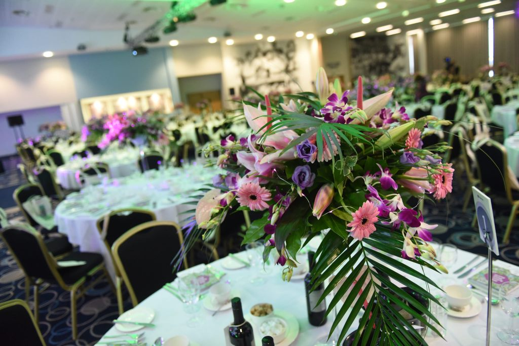 tables with flower displays at britain in bloom presentation