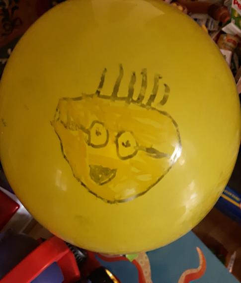 Luftballon mit Gesicht