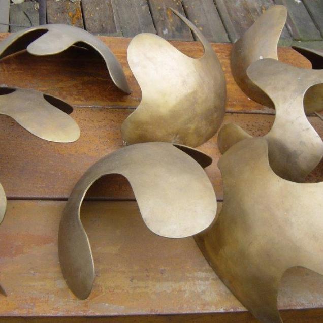 Scultura in bronzo composta da 7 elementi intercambiabili e scambiabili, sovrapponibili, ri- composti a sequenza variabile