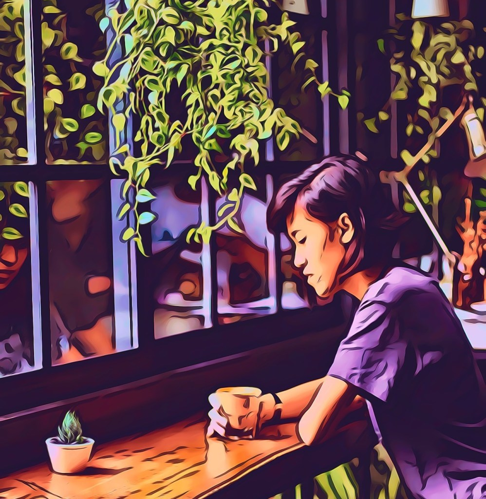 Woman in purple shirt, thinking at a coffee shop