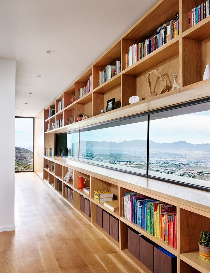 Window surrounded by bookshelves