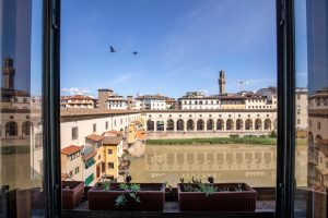 luxury real estate, window view of Ponte vecchio in Florence, Tuscany