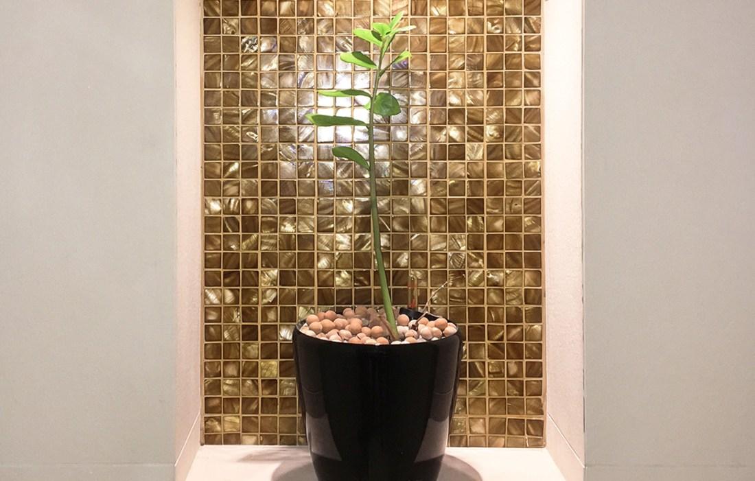 Bronze mosaic tiles in hotel bathroom