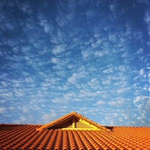 Tile roof and speckled clouds, afternoon, Civano.
