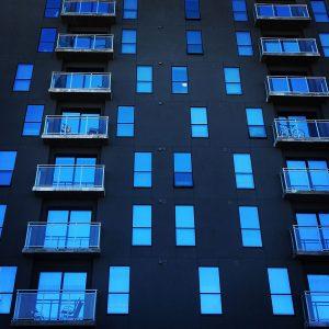 Windows reflecting the sky at highrise student housing near the University of Arizona in Tucson.