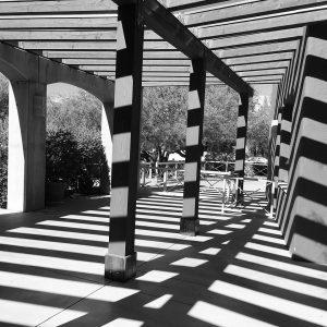 Portico beam shadows in the Civano neighborhood center.