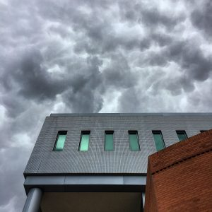Storm clouds above McClelland Hall at the University of Arizona.