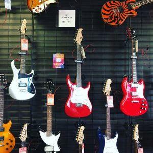 "Used guitars for sale at Bookman's in Tucson. And remember: no ""Stairway to Heaven."""