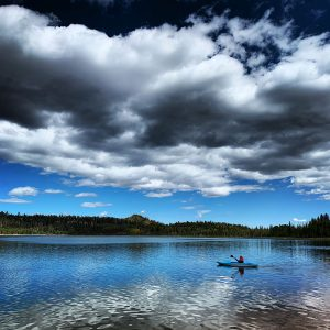 Paddling Navajo Lake in the Cedar Mountains of southern Utah.