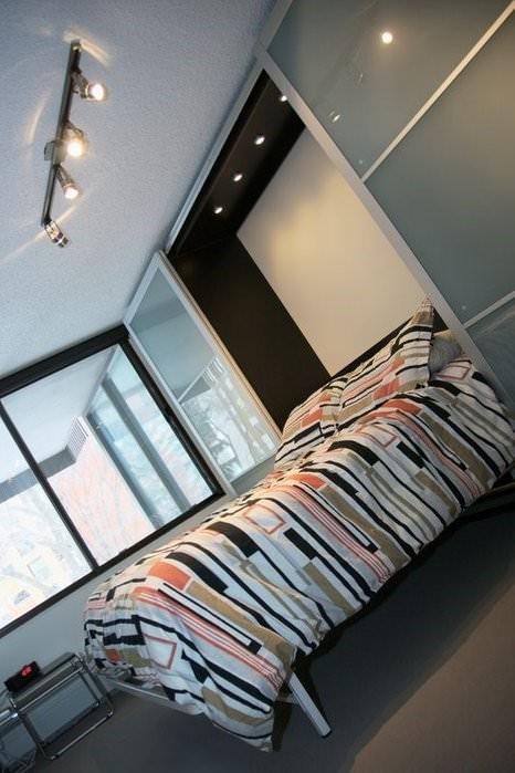 5. Ikea Hack Murphy Bed with Sliding Doors via Simphome