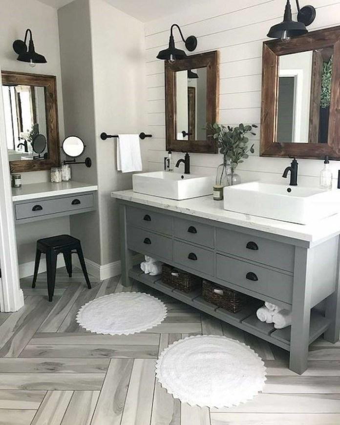 2. A Serene Farmhouse Bathroom via Simphome