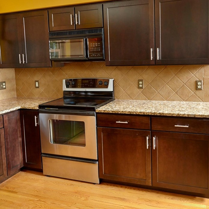 3. Refacing Kitchen Cabinets with Wood Veneer via Simphome.com