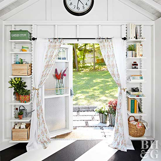 2. SIMPHOME.COM Stylish Garden Shed with Built In Bookshelves