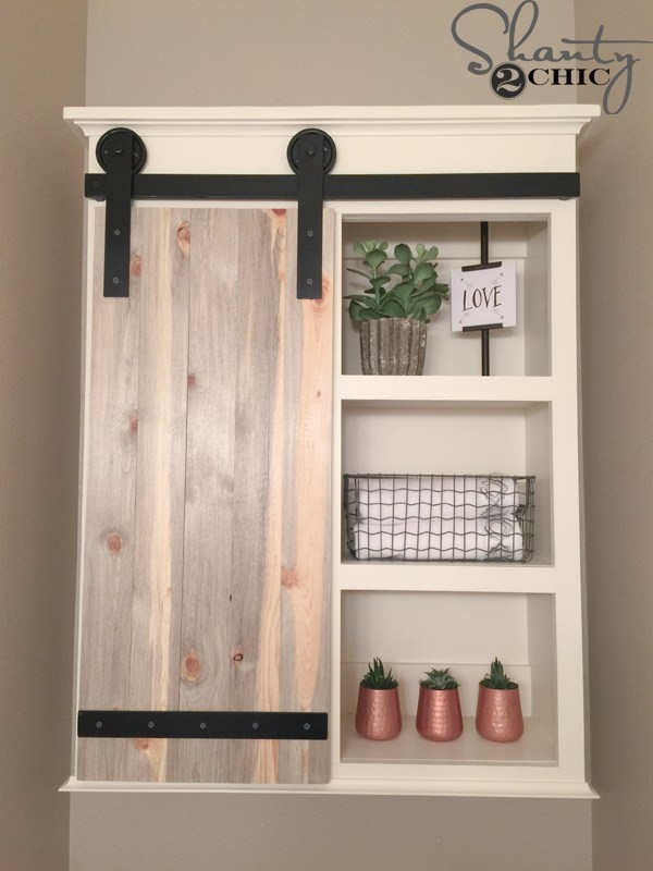 5. Sliding Barn Door Cabinet via SIMPHOME.COM