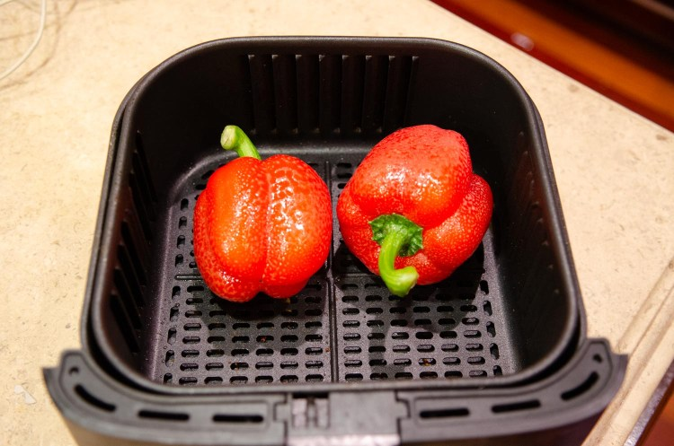 Red Peppers in an air fryer before roasting