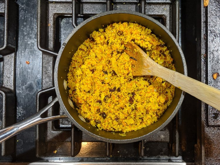 Savory Turmeric Couscous in a Sauce Pan after Fluffing