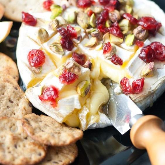 Baked brie w/ honey, cranberries, & pistachios