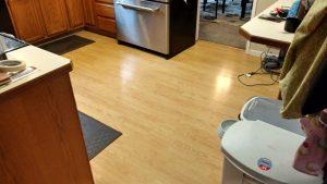 Old laminate flooring replaced with beautiful hardwood floors