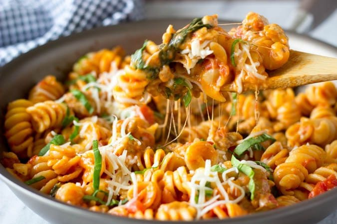 spicy sausage and spinach skillet pasta spoon