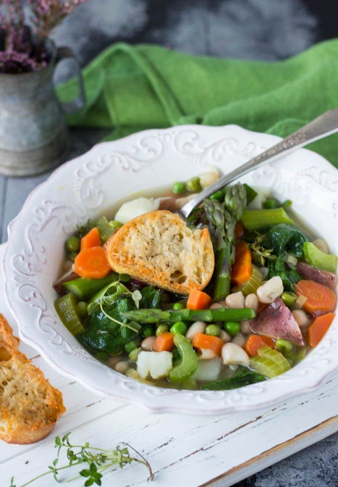 A quick and easy spring vegetable soup with giant Parmesan croutons.