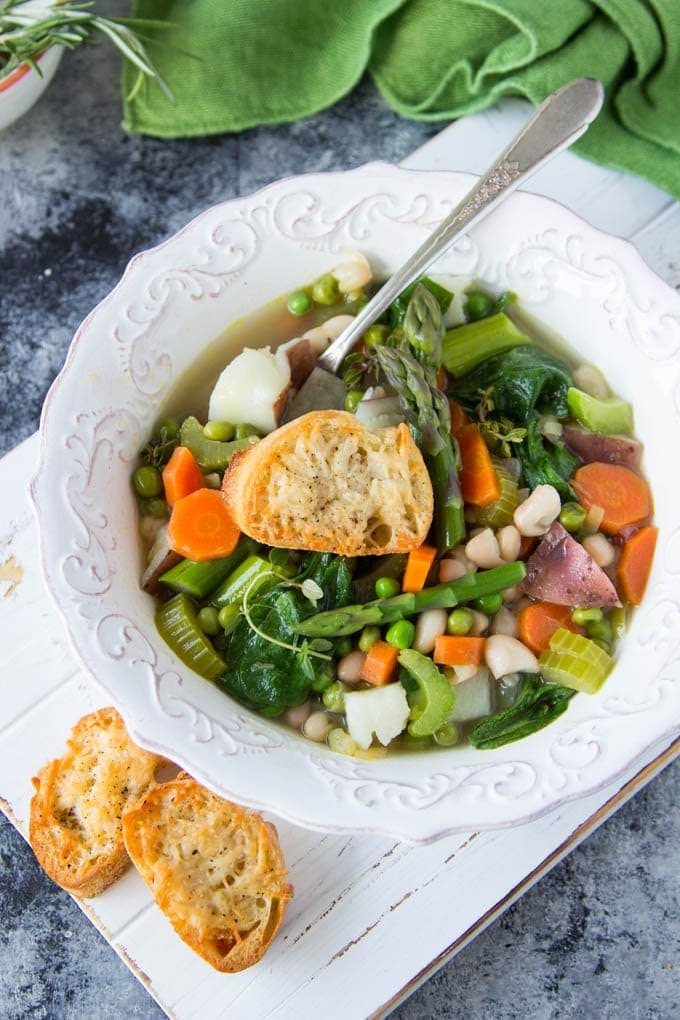 A quick and easy spring vegetable soup with giant Parmesan croutons | simplehealthykitchen.com