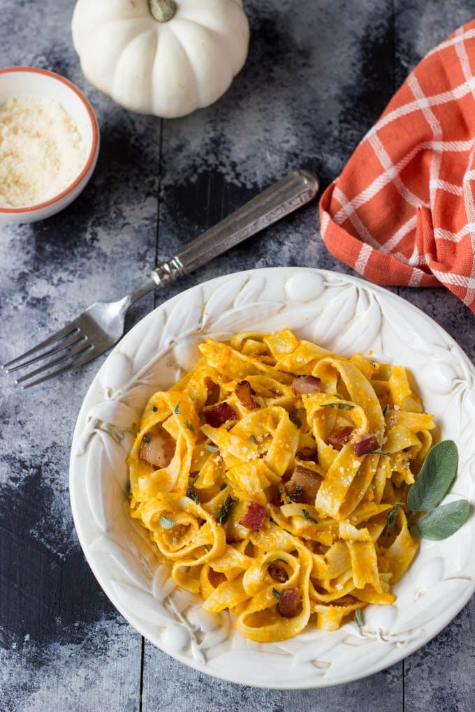 So easy! Only a few simple ingredients needed to make this healthy Fall inspired meal. Creamy pumpkin sauce tossed with fettuccine, Parmesan, bacon & sage | simplehealthykitchen.com #pumpkin # healthy #cleaneating