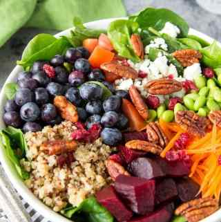 Quinoa + Spinach + Blueberry Superfood Bowl- A big bowl of nutritious goodness! Packed with 9 superfoods (quinoa, spinach, blueberries, carrots, edamame, beets, cranberries, tomatoes and pecans) these bright and colorful bowls not only pack in a lot of healthy nutrition , they are extremely tasty and keep you feeling full thanks to the combination of protein and fiber in these superfoods