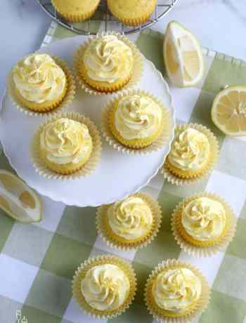 SIMPLE Lemon Cupcakes - these basic vanilla cupcakes get OOMPHED with tons of lemon and buttermilk for the moistest and lemony cupcakes #cupcakes #partyfood #mothersday #easterdessert #easterrecipes #simplepartyfood