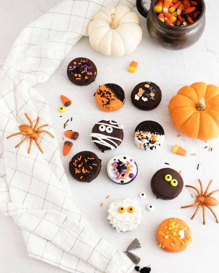 SIMPLE Chocolate Covered Halloween oreo Cookies - white and dark chocolate dipped with sprinkles and spooky edible eyes