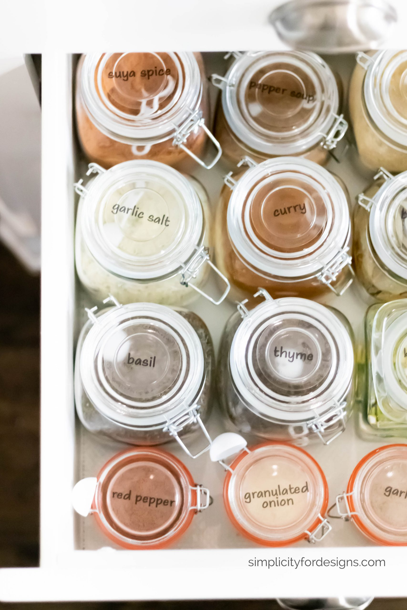 spice glass jars and spice bottles with labels