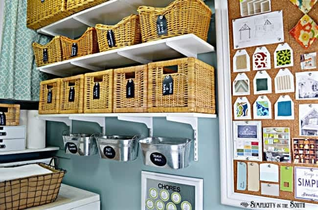 This small laundry room is big on organization ideas! Using baskets, bins, shelves along with hidden storage makes this 28 sq ft laundry room super organized and stylish.