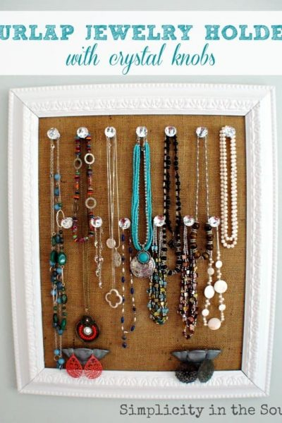Burlap jewelry holder with crystal knobs. Use upside down cup pulls to hold earrings and bracelets.
