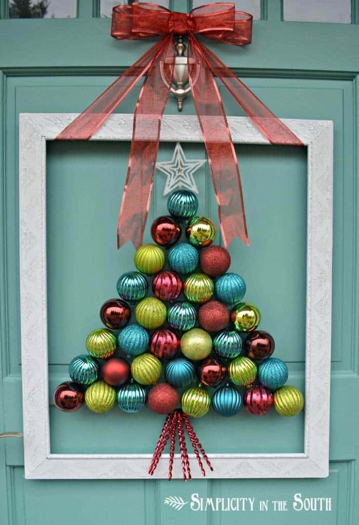 This is an adorable idea! This tutorial shows you how to make a DIY framed Christmas ornament wreath that looks like a Christmas tree!