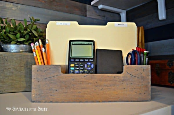 Organized office in a closet with distressed Ikea Mackis desk box