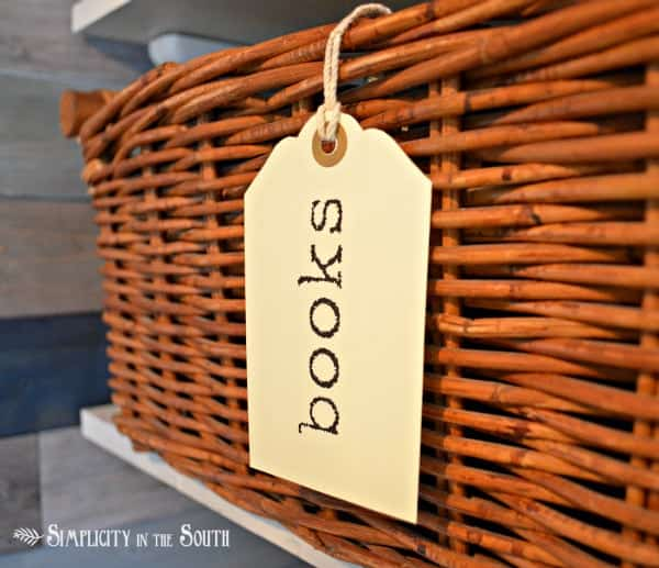 Organized office in a closet. Labeled baskets.