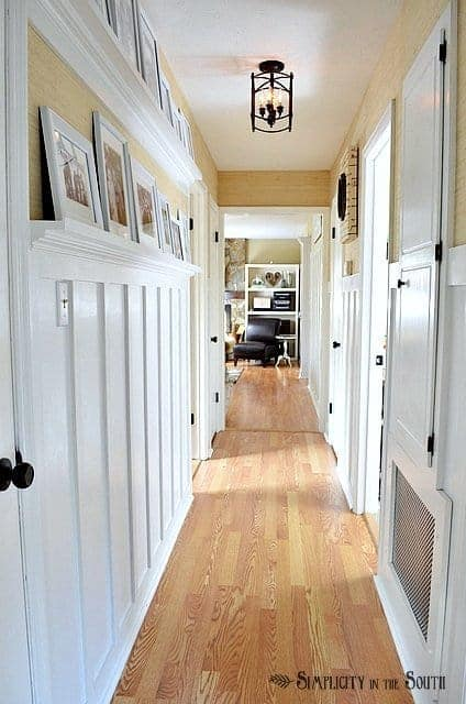 Board and batten hallway with gallery shelves