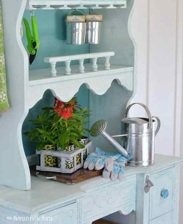 A potting bench that converts to a beverage station.