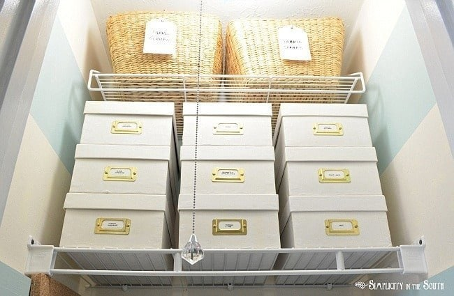 Small craft closet storage with boxes and baskets